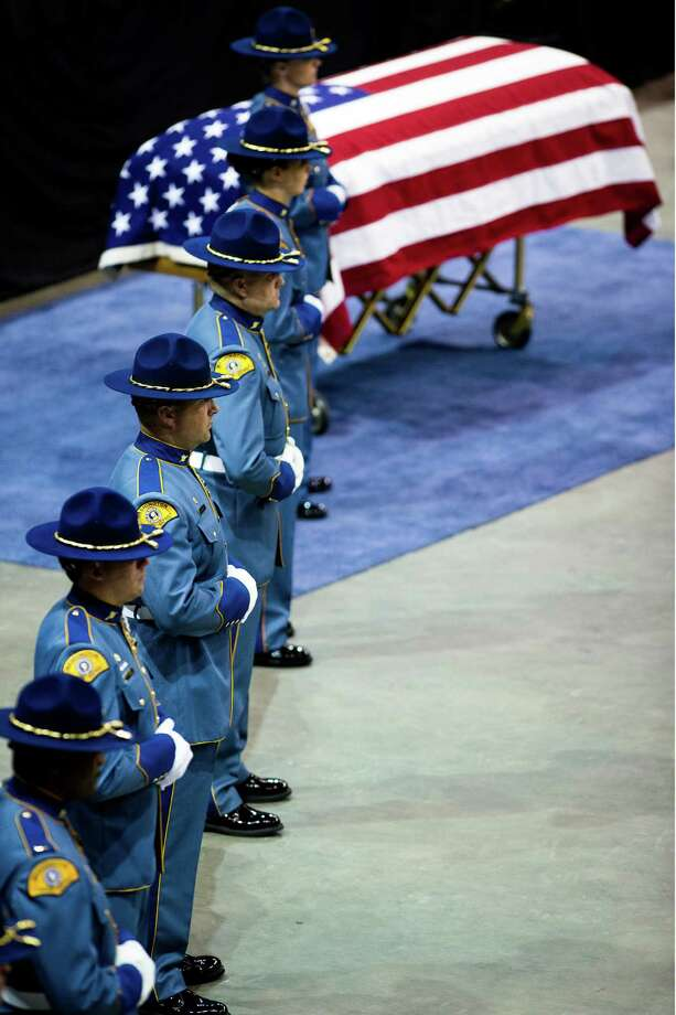 Washington State Patrol troopers watch over the casket of the late Trooper Sean M. O'Connell Jr. during a memorial service Thursday, June 6, 2013, at the Comcast Arena in Everett. Following a 13-mile vehicular procession, thousands of friends, family and law enforcement attended the ceremony. O'Connell was killed in a collision with a truck while working Conway. Photo: JORDAN STEAD, SEATTLEPI.COM / SEATTLEPI.COM