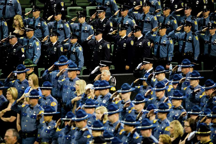 Washington State Patrol troopers salute the late Sean M. O'Connell Jr. at a memorial service Thursday, June 6, 2013, at the Comcast Arena in Everett. Following a 13-mile vehicular procession, thousands of friends, family and law enforcement attended the ceremony. O'Connell was killed in a collision with a truck while working Conway. Photo: JORDAN STEAD, SEATTLEPI.COM / SEATTLEPI.COM