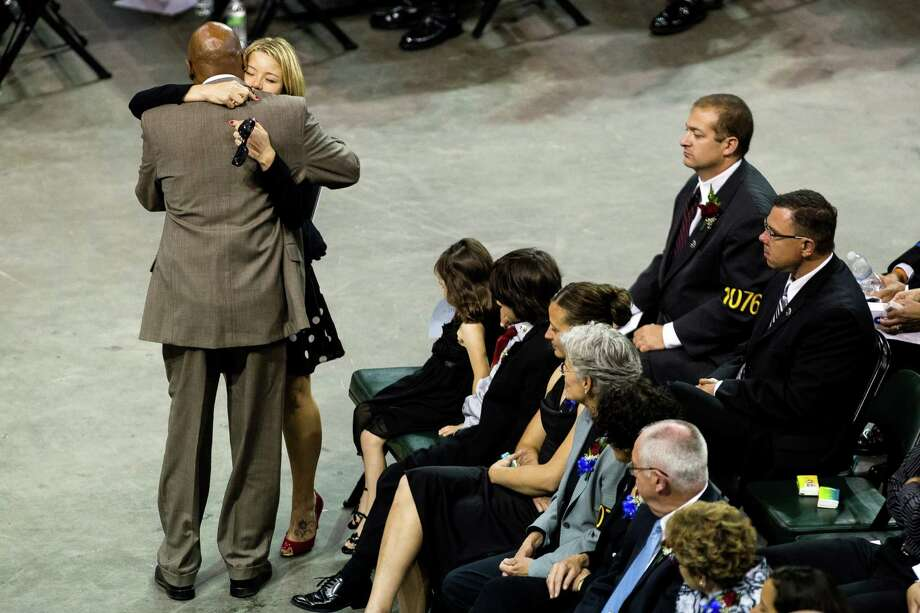 Snohomish County Executive John Lovick, left, embraces Alissa O'Connell, center left, widow of Washington State Trooper Sean O'Connell during a memorial service  her husband Thursday, June 6, 2013, at the Comcast Arena in Everett. Following a 13-mile vehicular procession, thousands of friends, family and law enforcement attended the ceremony. O'Connell was killed in a collision with a truck while working Conway. Photo: JORDAN STEAD, SEATTLEPI.COM / SEATTLEPI.COM