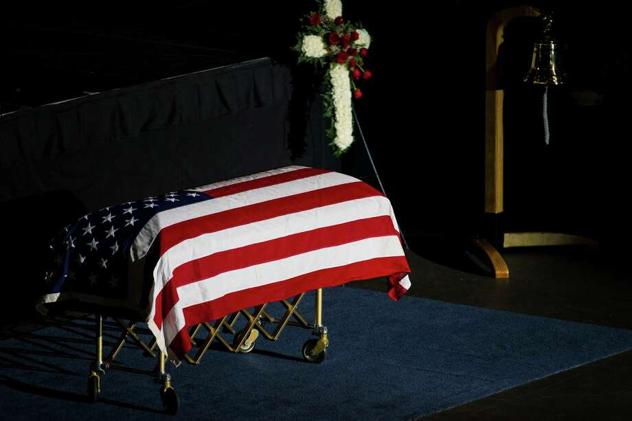 The casket of the late Washington State Patrol Trooper Sean M. O'Connell Jr. sits on display during a memorial service Thursday, June 6, 2013, at the Comcast Arena in Everett. Following a 13-mile vehicular procession, thousands of friends, family and law enforcement attended the ceremony. O'Connell was killed in a collision with a truck while working Conway. Photo: JORDAN STEAD, SEATTLEPI.COM / SEATTLEPI.COM