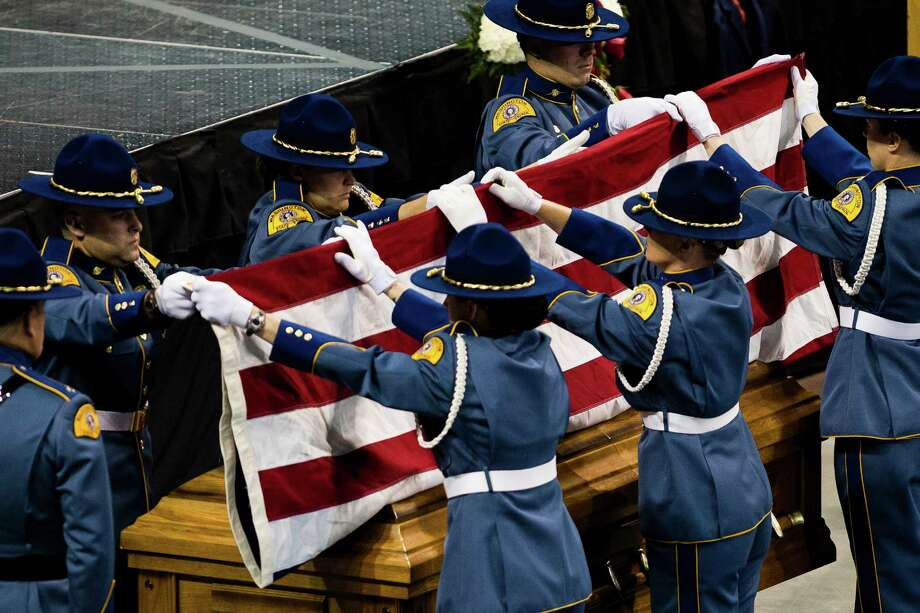 Washington State Patrol troopers fold a flag over a casket holding the late Washington State Patrol Trooper Sean M. O'Connell Jr. Thursday, June 6, 2013, at the Comcast Arena in Everett. Following a 13-mile vehicular procession, thousands of friends, family and law enforcement attended the ceremony. O'Connell was killed in a collision with a truck while working Conway. Photo: JORDAN STEAD, SEATTLEPI.COM / SEATTLEPI.COM