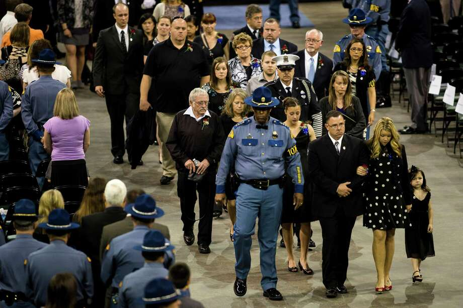 Following a 13-mile vehicular procession, thousands of friends, family and law enforcement attended a memorial service for the late Washington State Patrol Trooper Sean M. O'Connell Jr. Thursday, June 6, 2013, at the Comcast Arena in Everett. O'Connell was killed in a collision with a truck while working Conway. Photo: JORDAN STEAD, SEATTLEPI.COM / SEATTLEPI.COM
