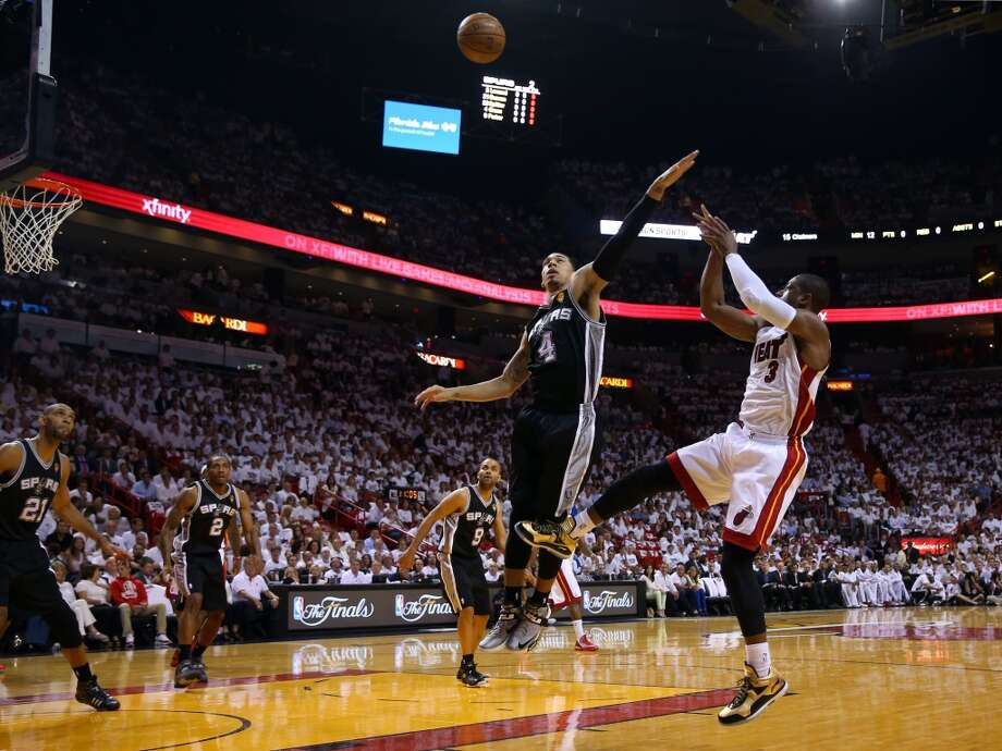 MIAMI, FL - JUNE 06:  Dwyane Wade #3 of the Miami Heat shoots over Danny Green #4 of the San Antonio Spurs in the first quarter during Game One of the 2013 NBA Finals at AmericanAirlines Arena on June 6, 2013 in Miami, Florida. NOTE TO USER: User expressly acknowledges and agrees that, by downloading and or using this photograph, User is consenting to the terms and conditions of the Getty Images License Agreement.  (Photo by Mike Ehrmann/Getty Images)