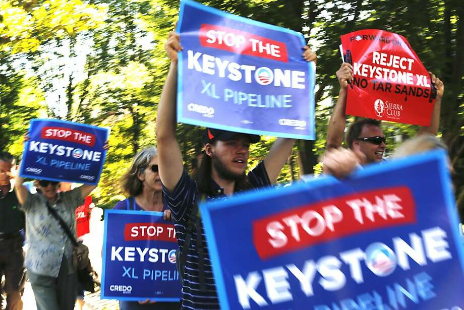 Opponents of the Keystone XL pipeline march toward Flipboard founder Michael McCue's Palo Alto home, where the president raised funds for the Democratic Senatorial Campaign Committee. Photo: Ian C. Bates, The Chronicle