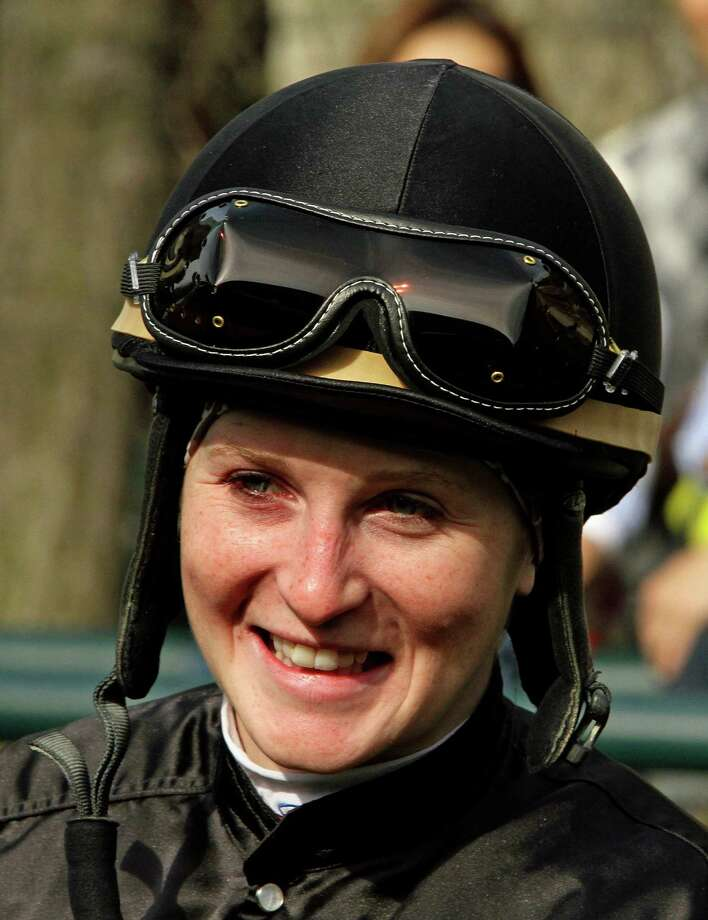 FILE - In this April 6, 2013 file photo.jockey Rosie Napravnik waits for her mount in the paddock before a horse race at Keeneland Race Course in Lexington, Ky. Napravnik tries to become the first female jockey to win the Kentucky Derby, a year after her ninth-place run here made her the highest female finisher. (AP Photo/Garry Jones, File) Photo: Garry Jones, FRE / FR50389 AP