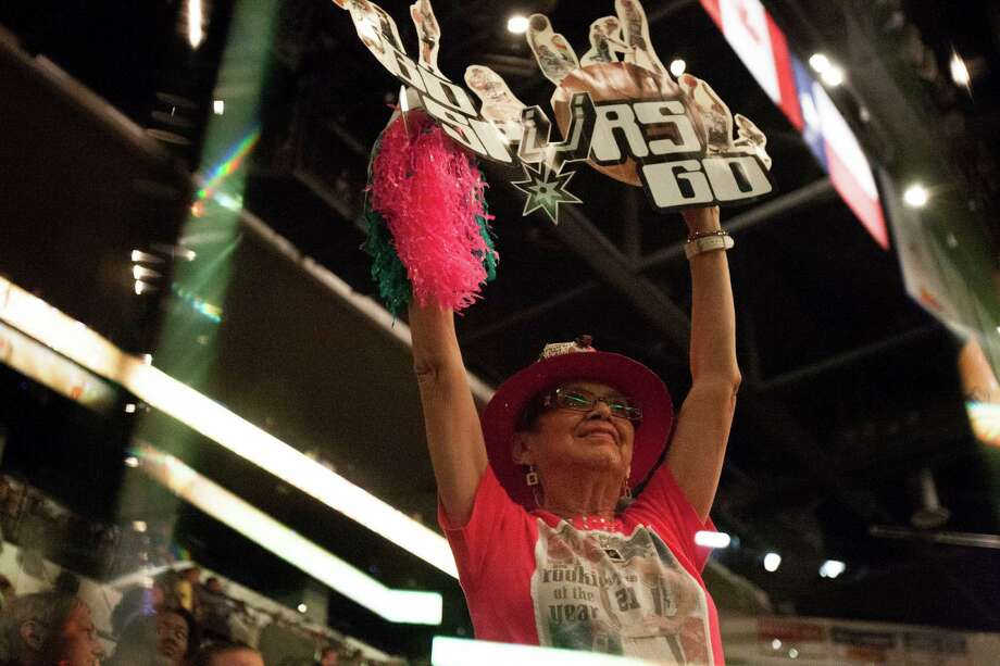 Mary Lou Rodriguez of San Antonio holds a sign at the Spurs viewing party at the AT&T center on Thursday. Photo: Abbey Oldham, San Antonio Express-News / © San Antonio Express-News