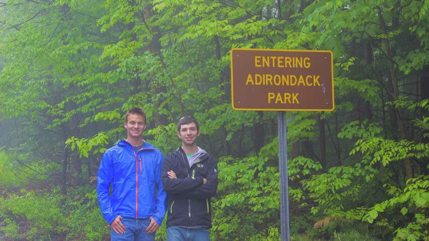 Photo provided by Ryan Wichelns. Stillwater residents Gabe Messercola, left, and Ryan Wichelns will start a 200-mile three-week odyssey across the Adirondack Park tomorrow. Here, they stand at their starting point, the border to the park on Route 309 near Benson.