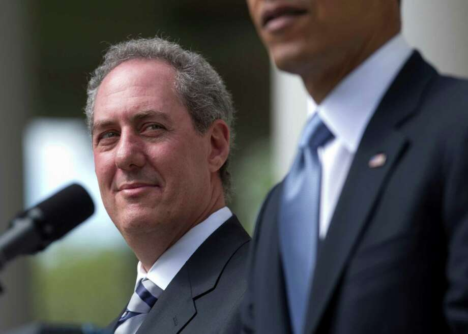 FILE - In this May 2, 2013 file photo, Michael Froman, President Barack Obama's choice to become US Trade Representative, listens as the president speaks in the Rose Garden of the White House in Washington. Forman appears headed for Senate confirmation despite Republican questions about nominee Michael Froman's investments in a hedge fund in the Cayman Islands, a well-known tax haven. (AP Photo/Carolyn Kaster, File) Photo: Carolyn Kaster, STF / AP