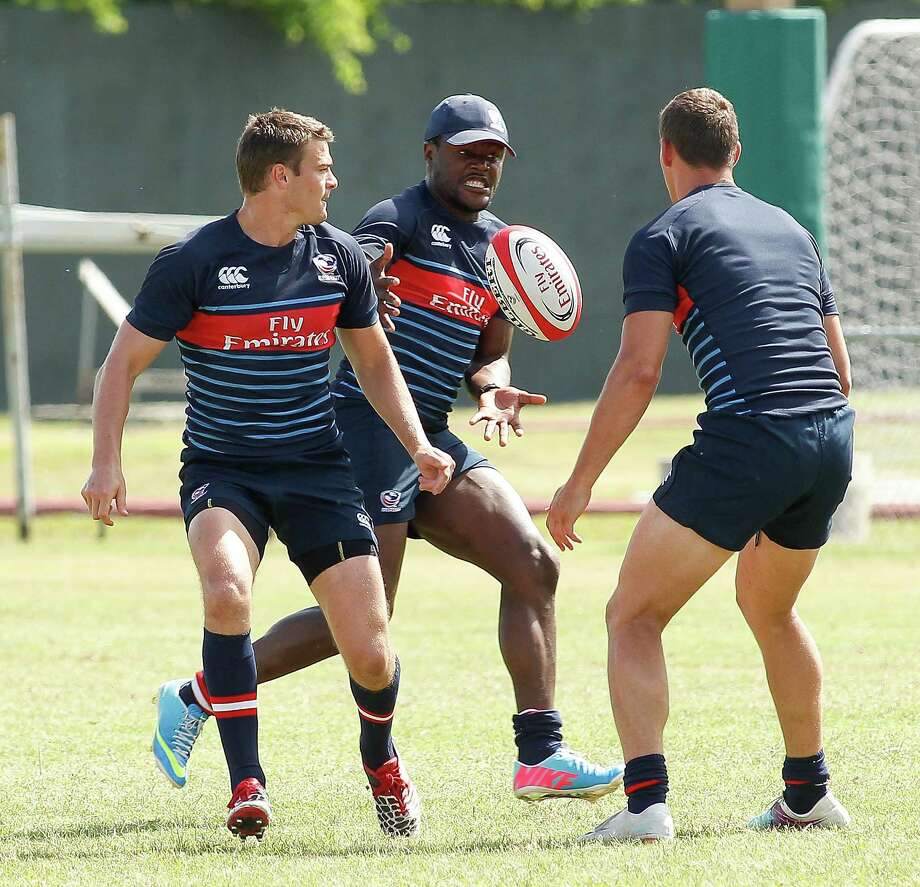 Takudzwa Ngwenya, center, practices with the U.S. rugby team Thursday. Ngwenya plays professionally in France and was added to the U.S. roster for punch. Photo: Bob Levey, Photographer / ©2013 Bob Levey