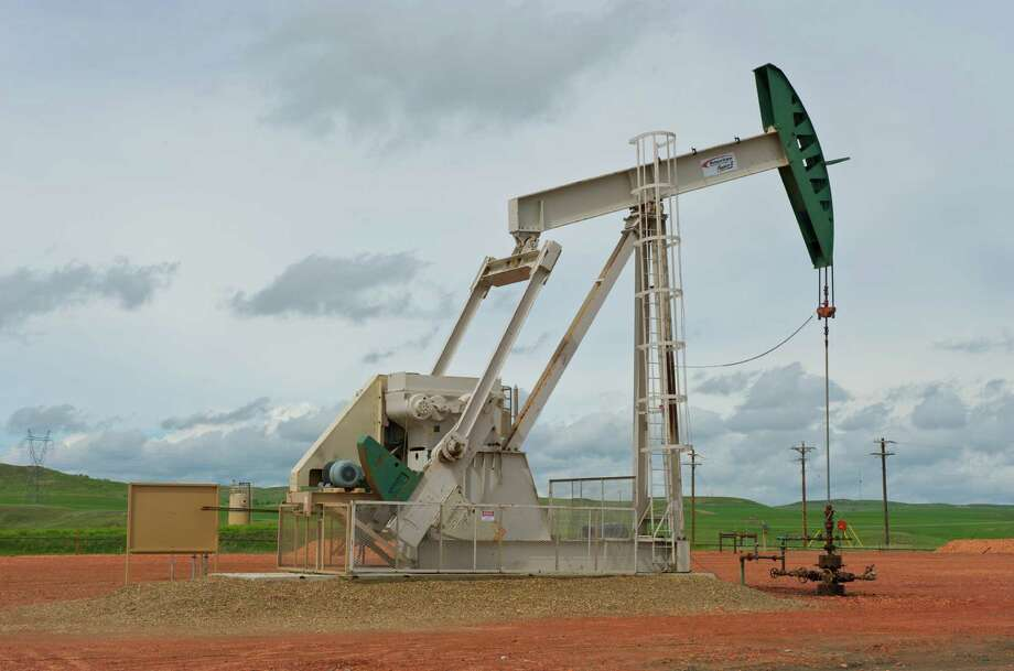 A pumpjack works on a ConocoPhillips project in the Bakken shale, a prolific oil region that stretches across parts of North Dakota and Montana.