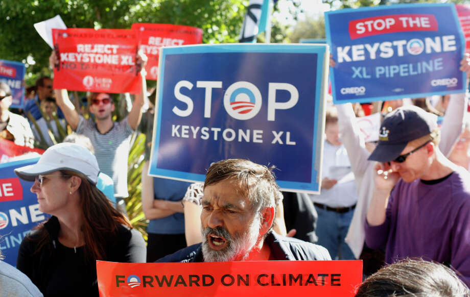 Protesters against the pipeline rally at a fundraiser attended by President Obama in June in Palo Alto. Photo: Ian C. Bates / The Chronicle / ONLINE_YES