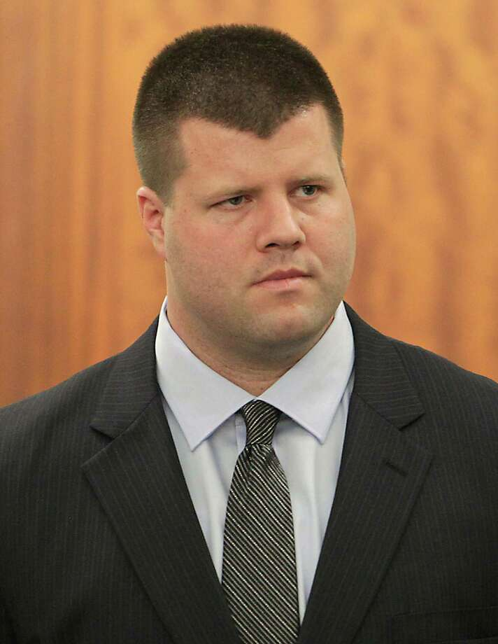 Former HPD officer Drew Ryser the fourth and final Houston police officer accused of wrongdoing in the 2010 videotaped beating of teenage burglar Chad Holley, stands in State District Judge Ruben Guerrero's 174th State District Court during his trial Monday, June 3, 2013, in Houston. ( James Nielsen / Houston Chronicle ) Photo: James Nielsen, Staff / © 2013  Houston Chronicle