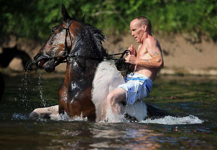 Pass the saddle soap:A traveler washes his horse in the waters of the River Eden in preparation for selling the animal at England's Appleby Horse Fair. Photo: Christopher Furlong, Getty Images