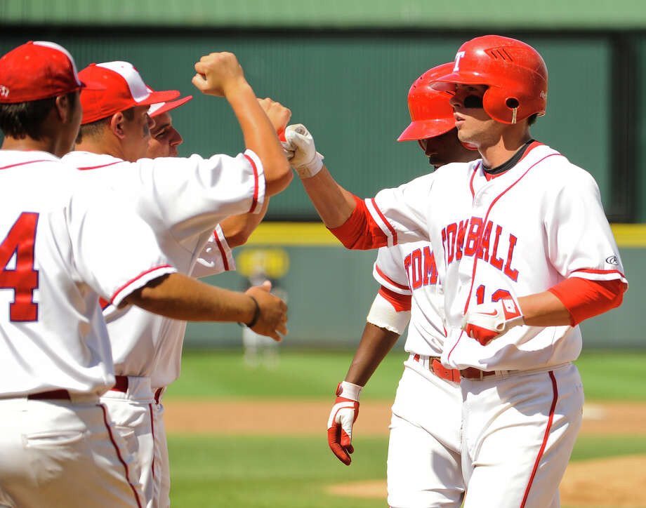 Tomball has reason to celebrate as the Cougars are one win away from capturing the Class 4A state championship after beating Wichita Falls Rider 5-2. Photo: Ashley Landis, Special Contributor / copyright 2013 Ashley Landis