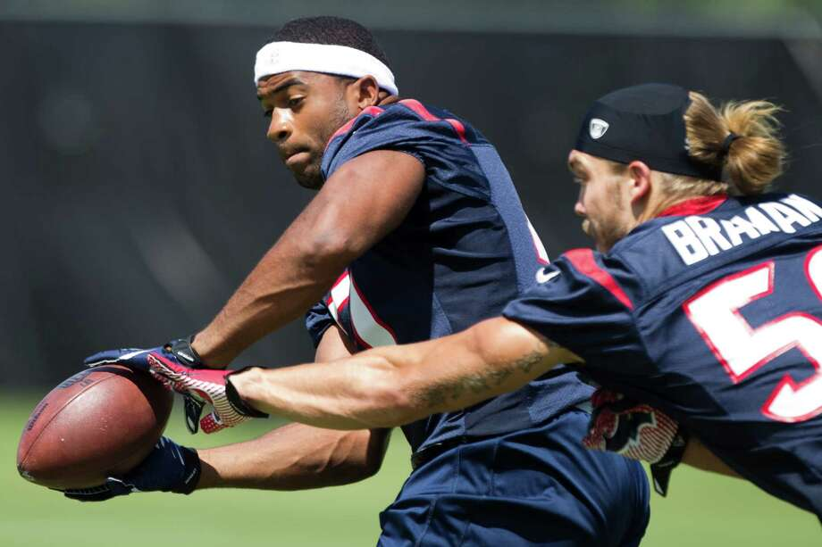 After a string of injuries, Texans linebacker Darryl Sharpton, left, did offseason research to determine how he can best prevent future injuries. Photo: Brett Coomer, Staff / © 2013 Houston Chronicle