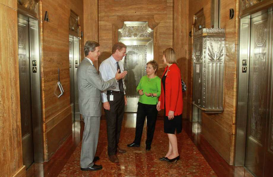 From left, Jeff Borland of Schindler Elevator Corp., Marc Vecchio, real estate manager at 712 Main, Nicole Saloio of Schindler;  and Laura Van Ness of Central Houston visit 712 Main's vintage lobby. Photo: Gary Fountain, Freelance / Copyright 2013 Gary Fountain