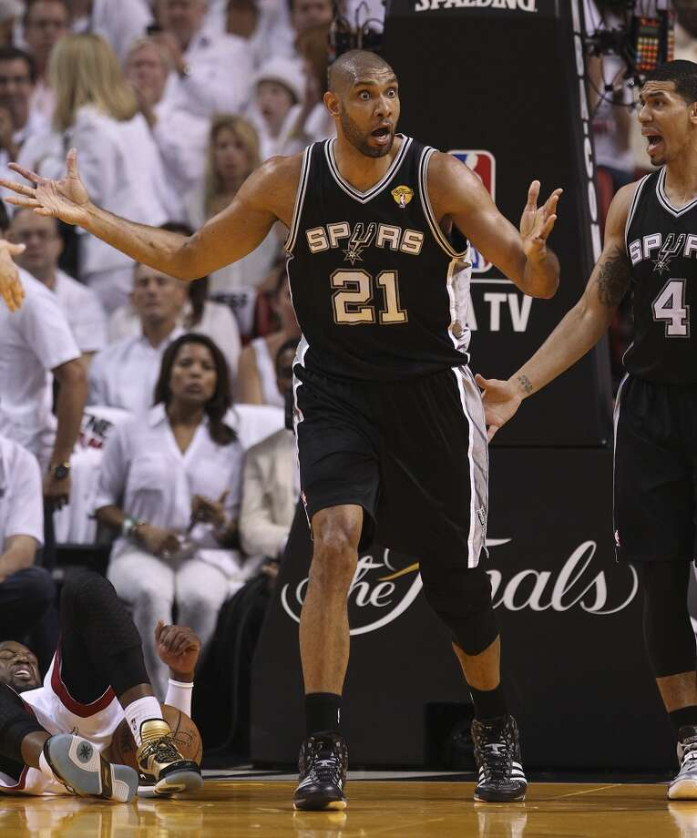 Spurs' Tim Duncan (21) reacts after a call for a foul as Miami Heats' Dwyane Wade (03) lays on the floor in the first half of Game 1 of the 2013 NBA Finals at the American Airlines Arena in Miami on Thursday, June 6, 2013.