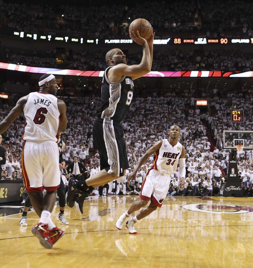 Spurs' Tony Parker (09) hits a clutch shot with second left  in the game against the Miami Heats' LeBron James (06) in the second half of Game 1 of the 2013 NBA Finals at the American Airlines Arena in Miami on Thursday, June 6, 2013. Spurs win 92-88. (Kin Man Hui/San Antonio Express-News)
