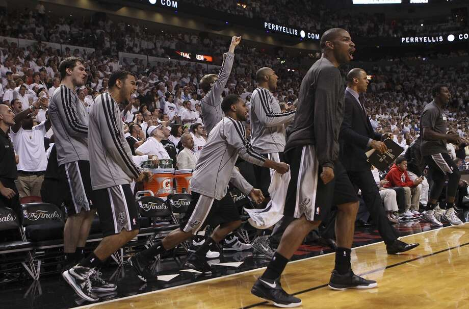 The Spurs bench erupts after Tony Parker's clutch shot late in the game against the Miami Heats in the second half of Game 1 of the 2013 NBA Finals at the American Airlines Arena in Miami on Thursday, June 6, 2013. Spurs won 92-88. (Kin Man Hui/San Antonio Express-News)