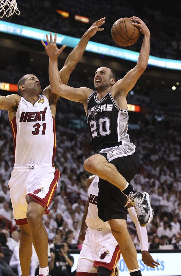 Spurs' Manu Ginobili (20) goes up for a shot against Miami Heats' Shane Battier (31) in the first half of Game 1 of the 2013 NBA Finals at the American Airlines Arena in Miami on Thursday, June 6, 2013.