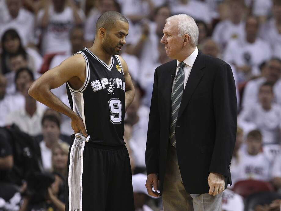 Spurs' Tony Parker (09) chats with Spurs coach Gregg Popovich in the first half of Game 1 of the 2013 NBA Finals at the American Airlines Arena in Miami on Thursday, June 6, 2013.