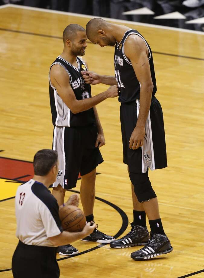 Spurs' Tony Parker (left) and Tim Duncan meet before the start of Game 1 of the 2013 NBA Finals Thursday June 6, 2013 at American Airlines Arena in Miami, Fla.