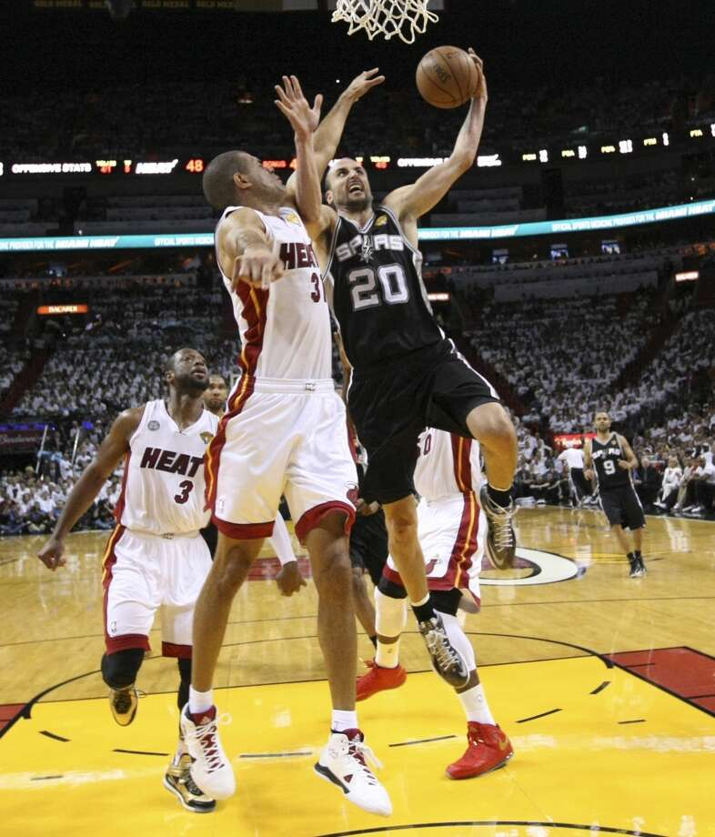 Spurs' Manu Ginobili (20) drives to the basket against Miami Heats' Shane Battier (31) during Game 1 of the 2013 NBA Finals Thursday June 6, 2013 at American Airlines Arena in Miami, Fla.
