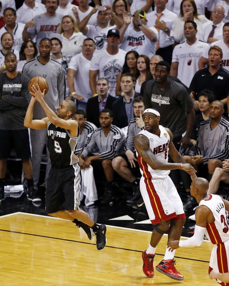 San Antonio Spurs' Tony Parker shoots late in second half action of Game 1 of the 2013 NBA Finals as Miami Heat's LeBron James and Miami Heat's Ray Allen look on Thursday June 6, 2013 at American Airlines Arena in Miami, Fla. The Spurs won 92-88.