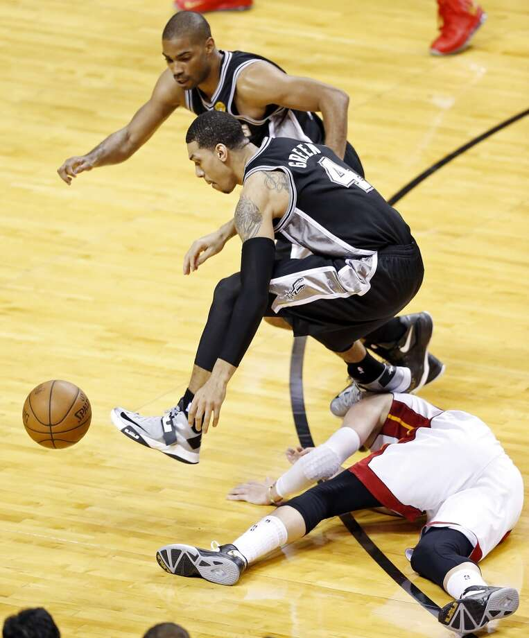 San Antonio Spurs' Gary Neal and San Antonio Spurs' Danny Green chase after a loose ball over Miami Heat's Mike Miller in the second half of Game 1 of the 2013 NBA Finals Thursday June 6, 2013 at American Airlines Arena in Miami, Fla.