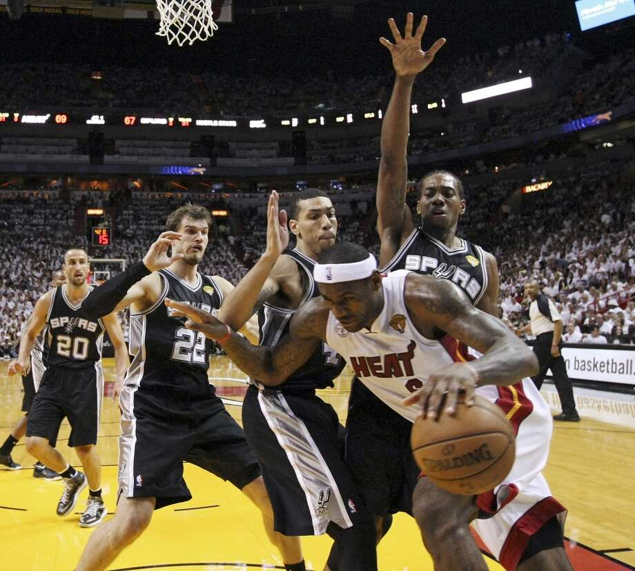 San Antonio Spurs' Tiago Splitter, San Antonio Spurs' Danny Green, and San Antonio Spurs' Kawhi Leonard defend Miami Heat's LeBron James in the second half of Game 1 of the 2013 NBA Finals Thursday June 6, 2013 at American Airlines Arena in Miami, Fla. The Spurs won 92-88.