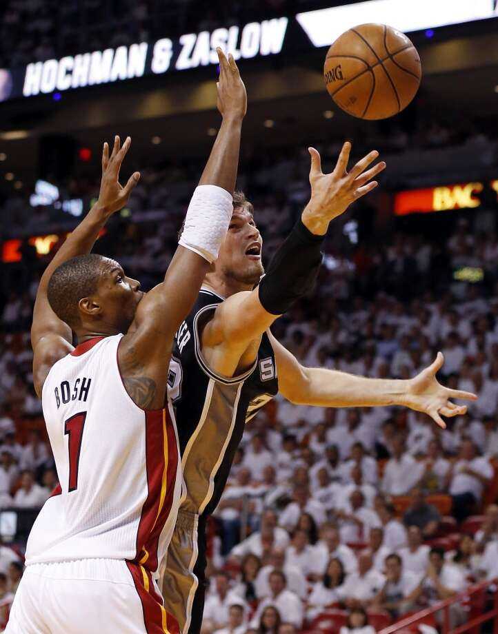 San Antonio Spurs' Tiago Splitter shoots around Miami Heat's Chris Bosh in the second half of Game 1 of the 2013 NBA Finals Thursday June 6, 2013 at American Airlines Arena in Miami, Fla.
