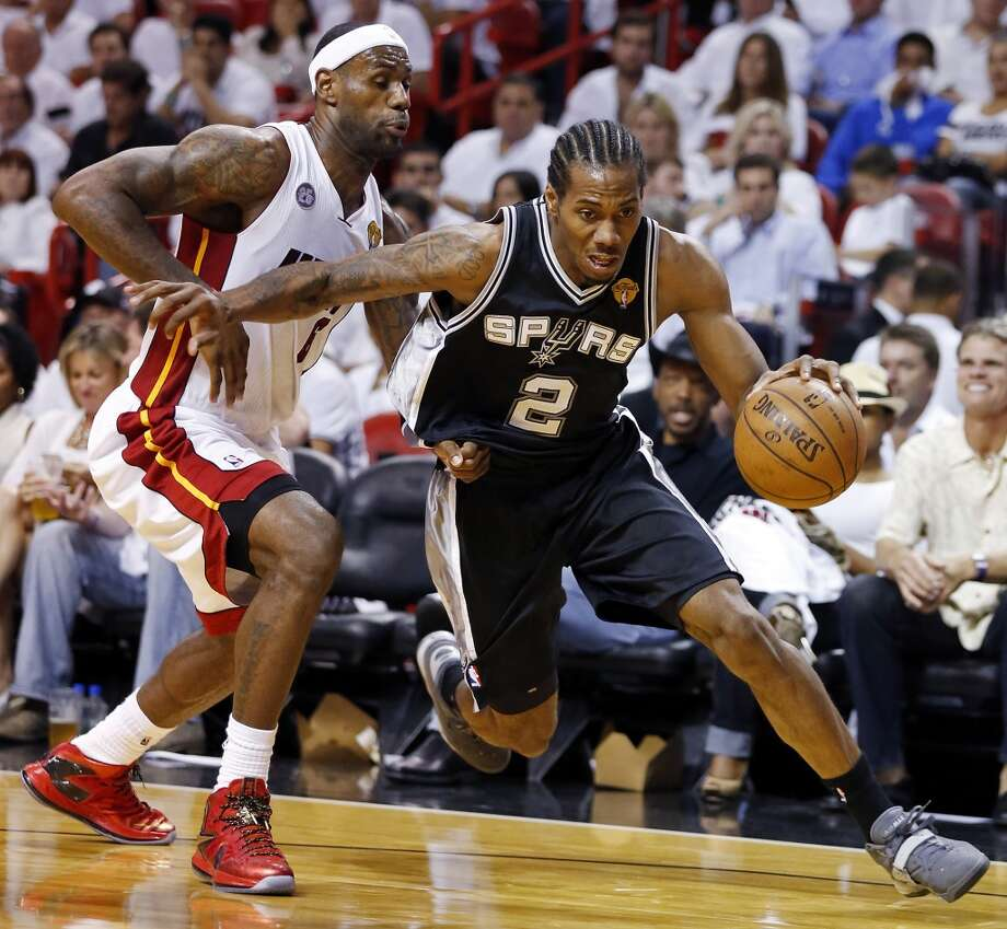 San Antonio Spurs' Kawhi Leonard drives around Miami Heat's LeBron James in the second half of Game 1 of the 2013 NBA Finals Thursday June 6, 2013 at American Airlines Arena in Miami, Fla.