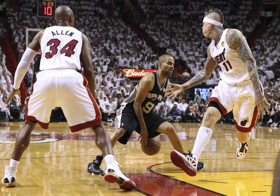 Spurs' Tony Parker (09) tricks Miami Heat's Chris Andersen (11) while driving toward the basket in the second half of Game 1 of the 2013 NBA Finals at the American Airlines Arena in Miami on Thursday, June 6, 2013. Spurs won 92-88. (Kin Man Hui/San Antonio Express-News)