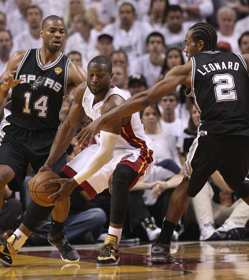 Spurs' Kawhi Leonard (02) and Gary Neal (14) put defensive pressure on Miami Heats' Dwyane Wade (03) in the second half of Game 1 of the 2013 NBA Finals at the American Airlines Arena in Miami on Thursday, June 6, 2013. (Kin Man Hui/San Antonio Express-News)