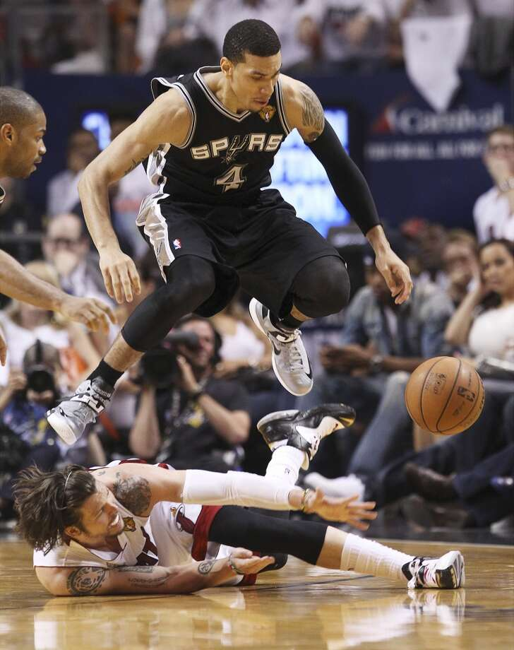 Spurs' Danny Green (04) leaps over Miami Heats' Mike Miller (13) while going for a loose ball in the second half of Game 1 of the 2013 NBA Finals at the American Airlines Arena in Miami on Thursday, June 6, 2013. (Kin Man Hui/San Antonio Express-News)