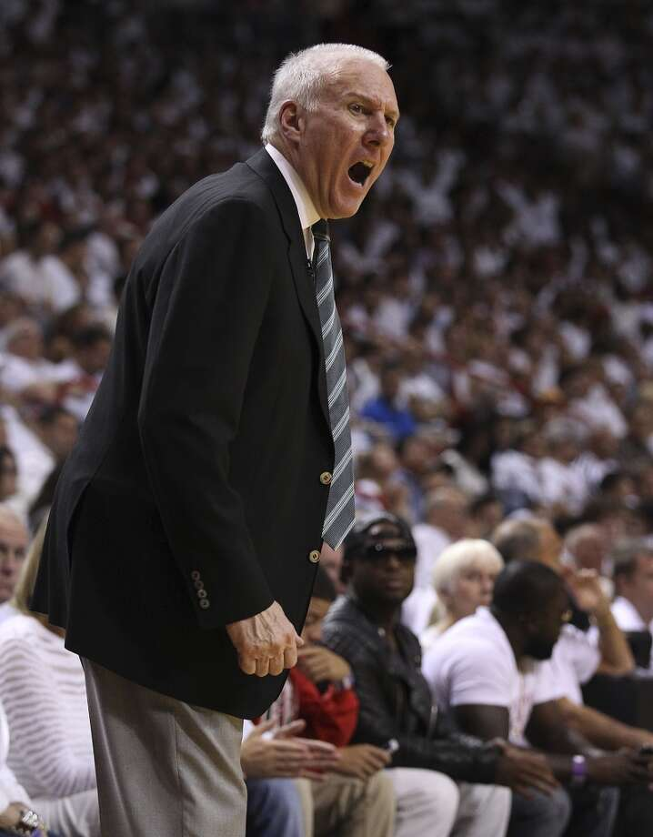 Spurs Spurs coach Gregg Popovich yells at a game official during the game against the Miami Heat in the second half of Game 1 of the 2013 NBA Finals at the American Airlines Arena in Miami on Thursday, June 6, 2013. (Kin Man Hui/San Antonio Express-News)