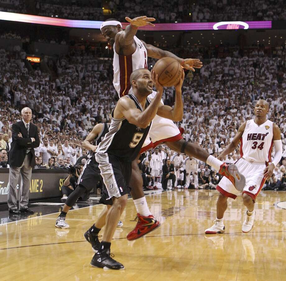 Spurs' Tony Parker (09) weaves around Miami Heats' LeBron James (06) to make a clutch shot late ein the second half of Game 1 of the 2013 NBA Finals at the American Airlines Arena in Miami on Thursday, June 6, 2013. Spurs defeated the Heat, 92-88. (Kin Man Hui/San Antonio Express-News)