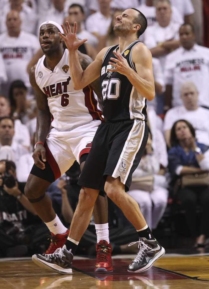 Spurs' Manu Ginobili (20) reacts after getting called for a foul against Miami Heats' LeBron James (06) in the second half of Game 1 of the 2013 NBA Finals at the American Airlines Arena in Miami on Thursday, June 6, 2013. Spurs defeated the Heat, 92-88. (Kin Man Hui/San Antonio Express-News)