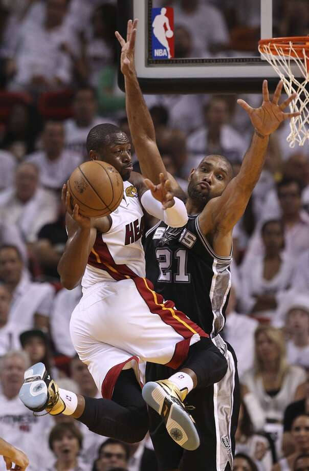 Spurs' Tim Duncan (21) defends against Miami Heats' Dwyane Wade (03) in the first half of Game 1 of the 2013 NBA Finals at the American Airlines Arena in Miami on Thursday, June 6, 2013. (Kin Man Hui/San Antonio Express-News)