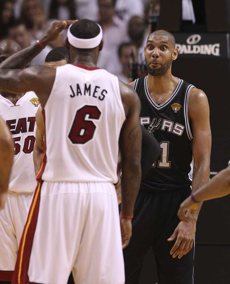 Spurs' Tim Duncan (21) talks to Miami Heats' LeBron James (06) before a jump ball in the first half of Game 1 of the 2013 NBA Finals at the American Airlines Arena in Miami on Thursday, June 6, 2013. (Kin Man Hui/San Antonio Express-News)