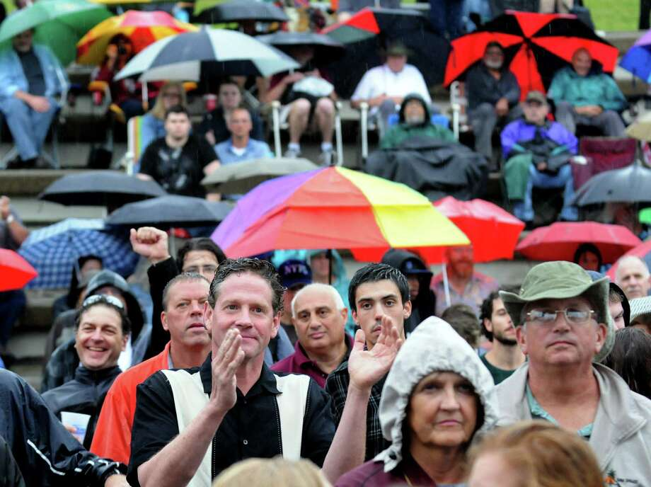 The rain doesn't deter music fans as they enjoy The Fabulous Thunderbirds during Alive at Five on Thursday, June 6, 2013, at Riverfront Park in Albany, N.Y. (Cindy Schultz / Times Union) Photo: Cindy Schultz / 00022727A