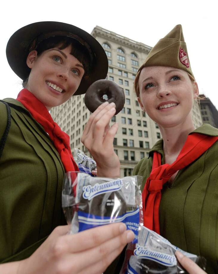 The Salvation Army donut lassies pass out Entenmann's donuts during the National Donut Day event in this 2013 file photo. Photo: JON SIMON, Associated Press / ENTENMANN'S