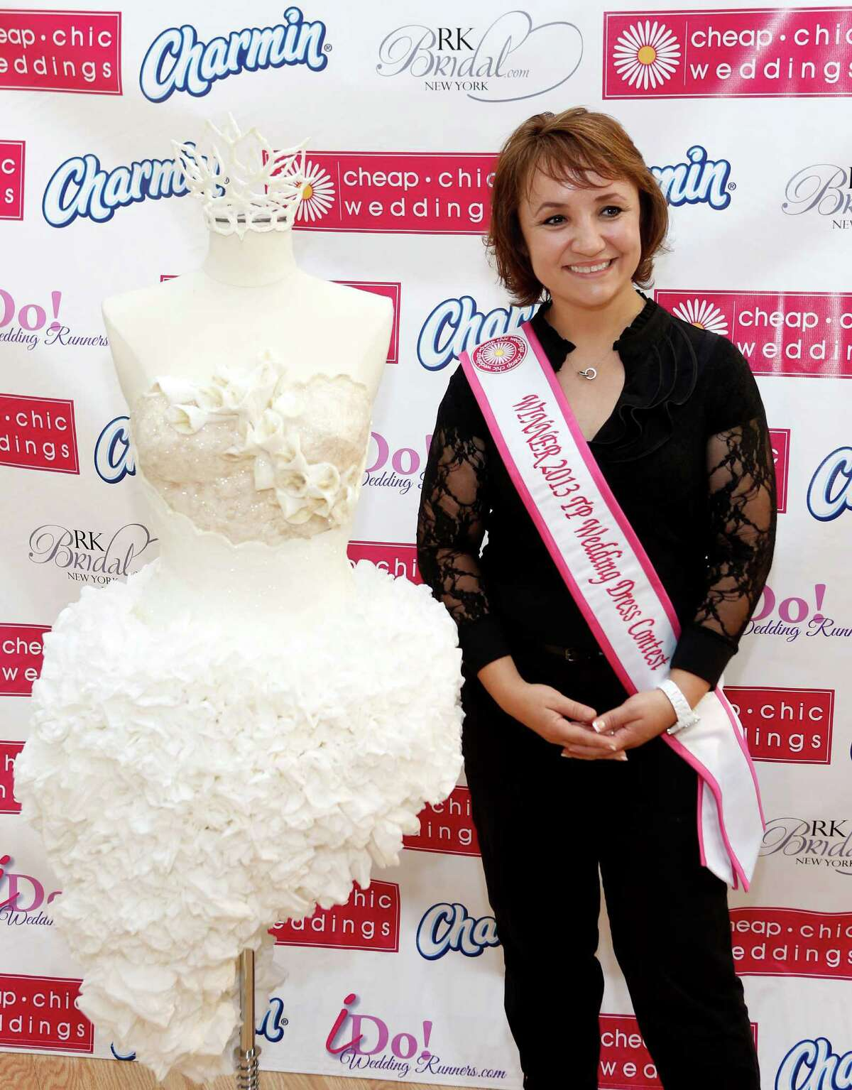 IMAGE DISTRIBUTED FOR CHARMIN - Crafted from 16 rolls of Charmin Ultra Soft, Mimoza Haska, of Surfside Beach, S.C., displayed her toilet paper couture dress at RK Bridal to win the ninth annual Cheap Chic Wedding Dress Contest sponsored by Charmin, Thursday, June 6, 2013, in New York.