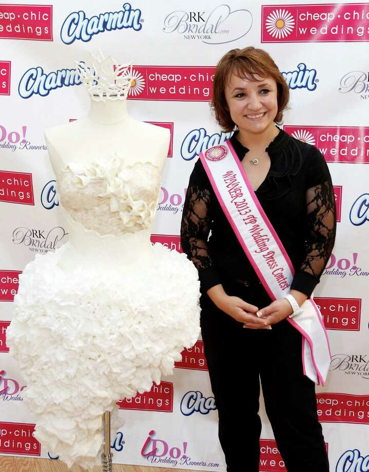 IMAGE DISTRIBUTED FOR CHARMIN - Crafted from 16 rolls of Charmin Ultra Soft, Mimoza Haska, of Surfside Beach, S.C., displayed her toilet paper couture dress at RK Bridal to win the ninth annual Cheap Chic Wedding Dress Contest sponsored by Charmin, Thursday, June 6, 2013, in New York. Photo: Jason DeCrow, AP Images For Charmin / AP Images