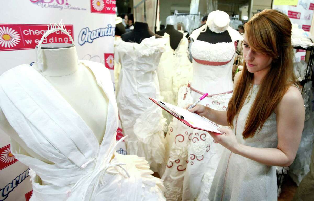 IMAGE DISTRIBUTED FOR CHARMIN - Project Runway's Season 11 contestant Kate Pankoke judges toilet paper masterpieces during the ninth annual Cheap Chic Wedding Dress Contest sponsored by Charmin, Thursday, June 6, 2013, in New York.