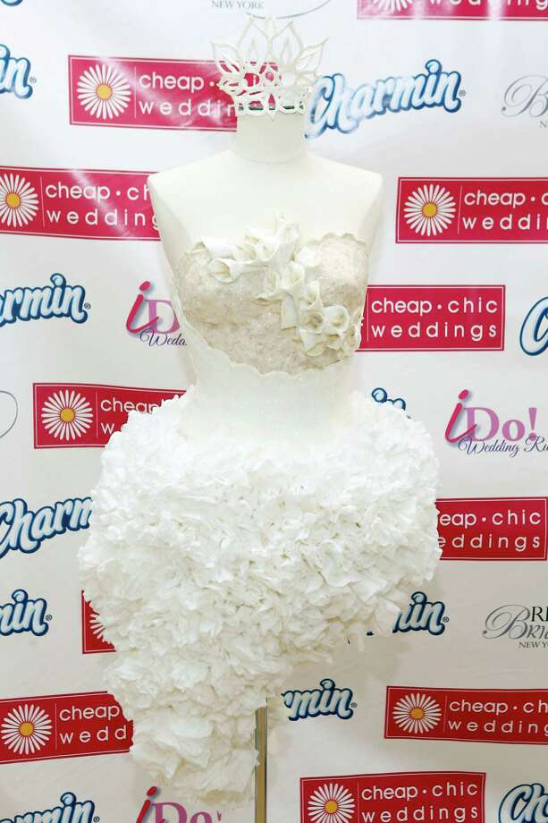 IMAGE DISTRIBUTED FOR CHARMIN - Crafted from 16 rolls of Charmin Ultra Soft by Mimoza Haska, of Surfside Beach, S.C., the winning toilet paper couture dress is displayed at RK Bridal during the ninth annual Cheap Chic Wedding Dress Contest sponsored by Charmin, Thursday, June 6, 2013, in New York. Photo: Jason DeCrow, AP Images For Charmin / AP Images