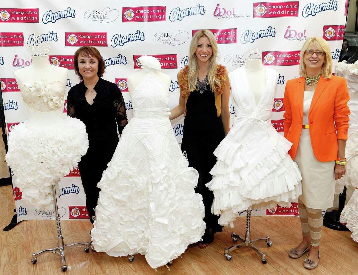 IMAGE DISTRIBUTED FOR CHARMIN - Finalists in the ninth annual Cheap Chic Wedding Dress Contest sponsored by Charmin rolled out toilet paper masterpieces for the chance to win $2,000, Thursday, June 6, 2013, in New York.