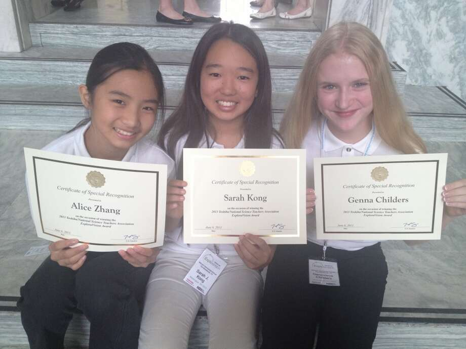Alice Zhang, Sarah Kong, and Genna Childers hold their Certificates of Special Recognition signed by Sen. Ted Cruz.