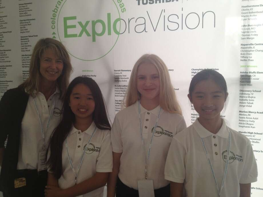 Teacher Dawn Caldwell with her students, Sarah Kong,Genna Childers, and Alice Zhang at the ExploraVision Congressional Science Fair.