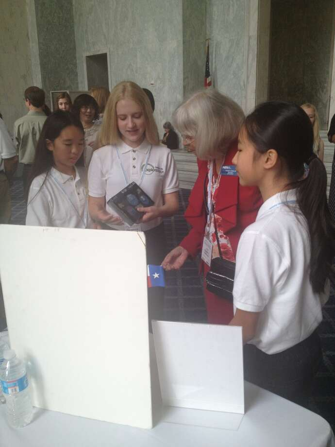 The student team presents their project to NSTA Retiring President, Dr. Karen L. Ostlund.